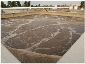 An aeration basin at a wastewater treatment plant.